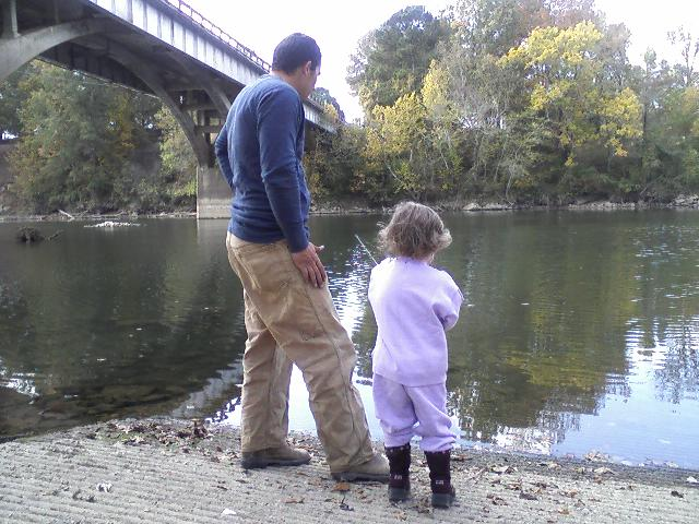 My girls and THEIR daddy fishing with Daddy's poles down at the river